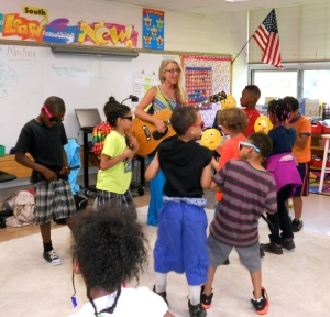 Susan Harrison, KVBA Blues In Schools presentor, jamming with students at Spring Valley Center for Exploration